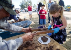 Amanda Rose Biava, 6, makes adobe bricks during the annual Fort Lowell Day Celebration at Fort Lowell Park in Tucson, Ariz. Saturday, Feb. 8, 2014. STEVE MARCUS
